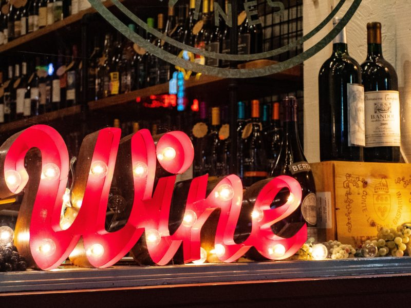 red wine marquee signage on table 1374552